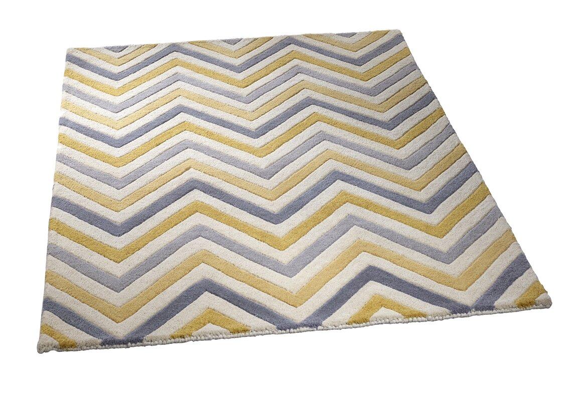 urban facettes handgetufteter teppich eta cabone in gelb grau bewertungen. Black Bedroom Furniture Sets. Home Design Ideas