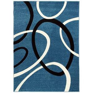 Ayer Hand-Carved Blue Area Rug