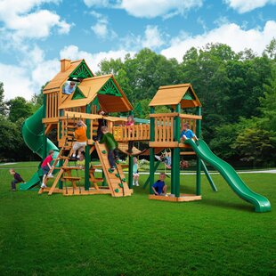 Treasure Trove I Timber Shield™ Posts Swing Set. By Gorilla Playsets