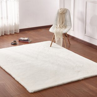 Lineberger Hand Woven Faux Fur Off White Area Rug