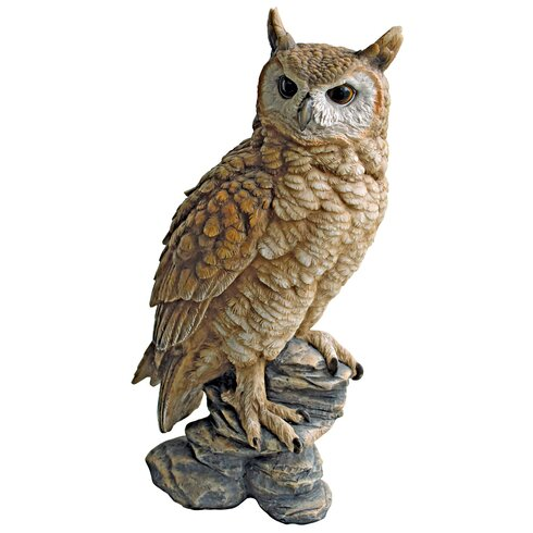Statue Owl Sitting on Rock