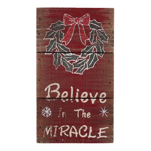 believe in the miracle christmas sign