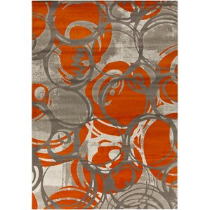 Clifford Machine Woven Orange Area Rug