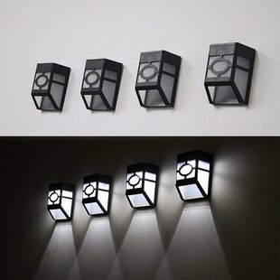 Solar powered outdoor wall lighting youll love wayfair gherardo solar and battery powered 4 light outdoor wall lantern set of 4 aloadofball Image collections