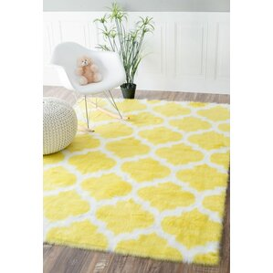 rosemarie faux sheepskin yellow area rug