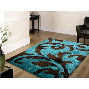 Mthimunye Hand Tufted Brown Turquoise Area Rug