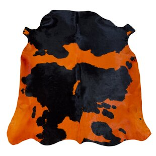 Normand Cowhide Black/Orange Rug by Pieles Pipsa