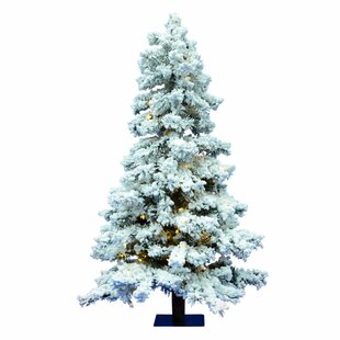flocked 6 spruce artificial christmas tree with 722 pvc tips and 300 warm white dura lit led lights