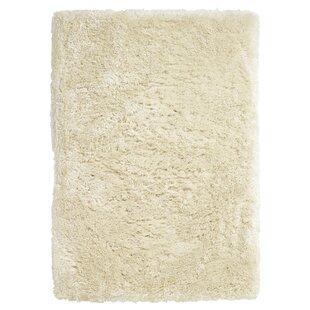 Polar Hand-Woven Rug in Cream by Caracella