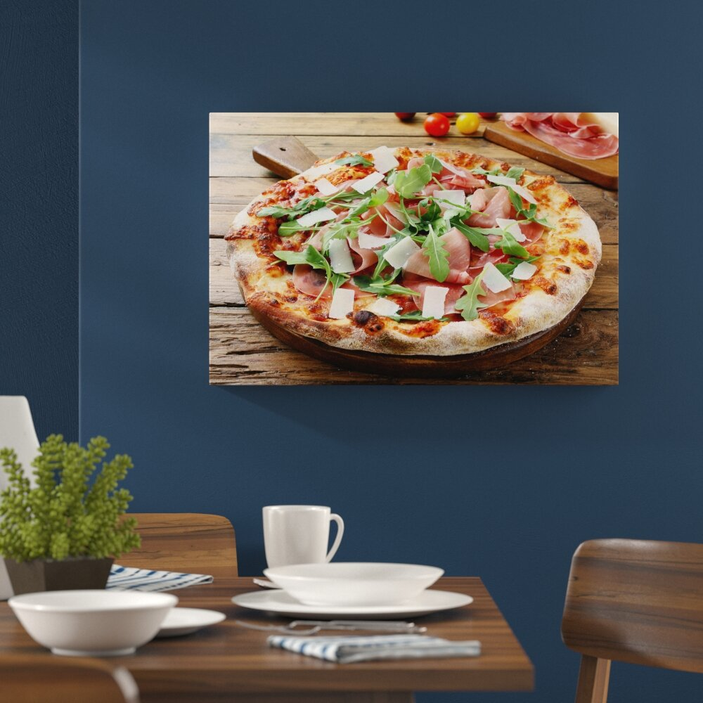 Prosciutto pizza with rocket and parmesan on a rustic wooden table wall art on canvas