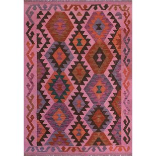 Earle Handwoven Wool Light Pink Area Rug
