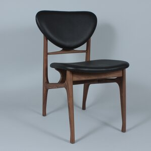 The Sandler Genuine Leather Upholstered Dining Chair by dCOR design