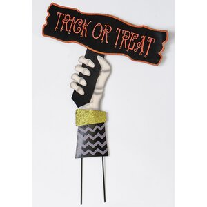 Hand Holding Trick Or Treat Sign