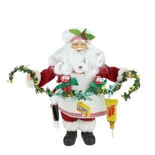 santa claus holding a garland with tootsie candies christmas decoration