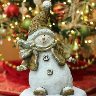 5208cf8ae8815 Whimsical Snowshoeing Ceramic Christmas Snowman Decorative Tabletop Figure