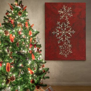 Christmas wall art paintings youll love wayfair snowflakes on red i photographic print on wrapped canvas solutioingenieria Choice Image