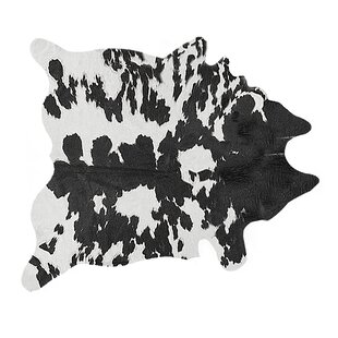 Faux Cowhide Black/White Area Rug Luxe