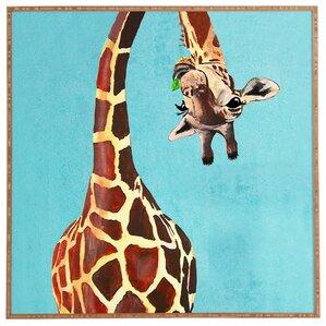 Giraffe With Green Leaf Framed Print