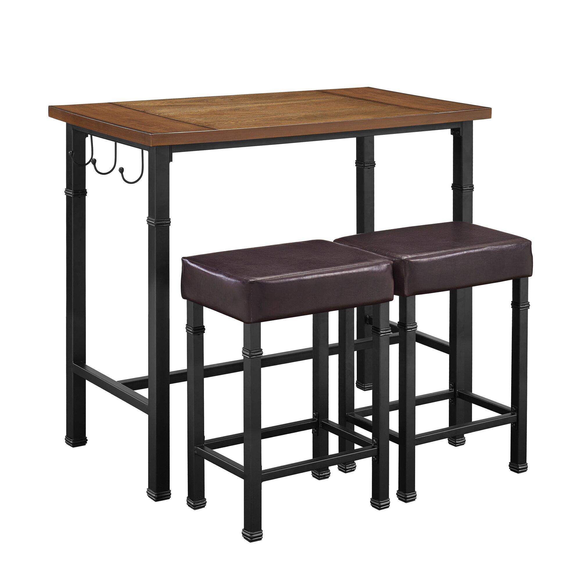 Laurel foundry modern farmhouse sevigny 3 piece pub table for Cie publication 85 table 2